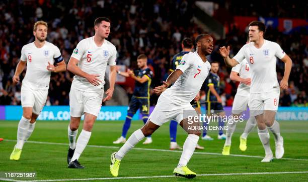 England's midfielder Raheem Sterling 2R0 celebrates after scoring the equalising goal during the UEFA Euro 2020 qualifying Group A football match...