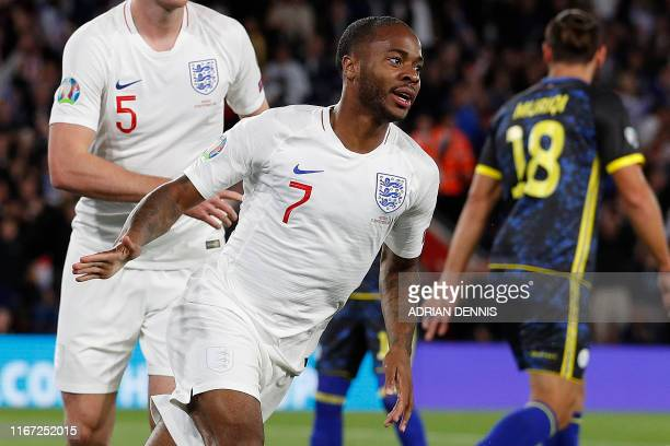 England's midfielder Raheem Sterling celebrates after scoring the equalising goal during the UEFA Euro 2020 qualifying Group A football match between...