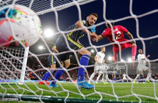 England's midfielder Raheem Sterling celebrates scoring his team's first goal during the UEFA Euro 2020 qualifying Group A football match between...