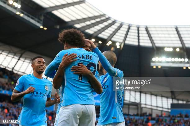 England's midfielder Raheem Sterling celebrates scoring their second goal with Manchester City's German midfielder Leroy Sane during the English...