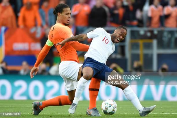 England's midfielder Raheem Sterling challenges Netherlands' defender Virgil Van Dijk during the UEFA Nations League semifinal football match between...