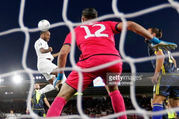 England's midfielder Raheem Sterling heads the ball to score his team's first goal during the UEFA Euro 2020 qualifying Group A football match...