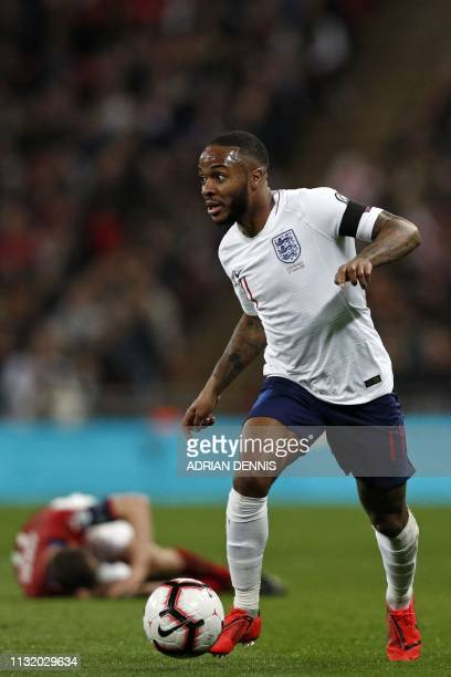England's midfielder Raheem Sterling runs with the ball during the UEFA Euro 2020 Group A qualification football match between England and Czech...