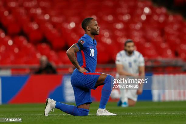 England's midfielder Raheem Sterling takes a knee against racism before kick off of the FIFA World Cup Qatar 2022 qualification football match...