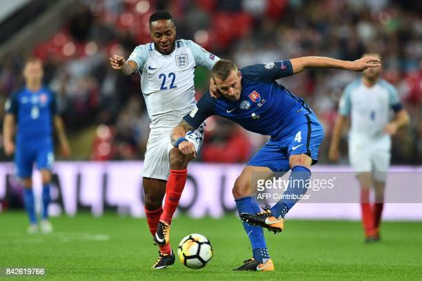 England's midfielder Raheem Sterling vies with Slovakia's defender Jan Durica during the World Cup 2018 qualification football match between England...