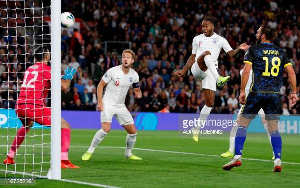 England's midfielder Raheem Sterling watches the ball after heading to score the equalising goal during the UEFA Euro 2020 qualifying Group A...