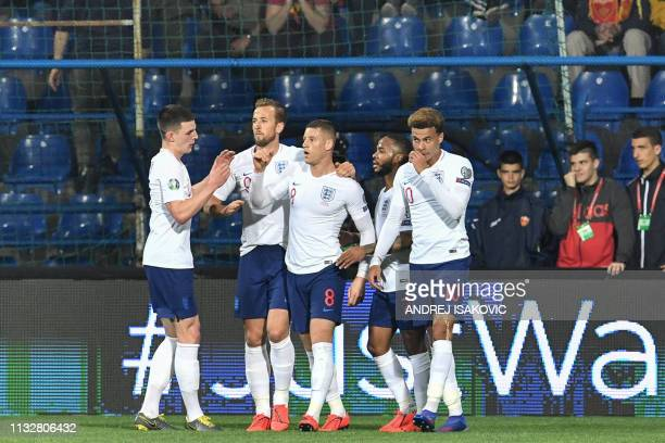 England's midfielder Ross Barkley celebrates with teammates after scoring a goal during the Euro 2020 football qualification match between Montenegro...