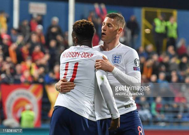England's midfielder Ross Barkley celebrates with teammates after scoring his second goal of the Euro 2020 football qualification match between...