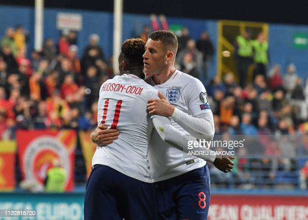 England's midfielder Ross Barkley is congratulated by England's midfielder Callum HudsonOdoi after scoring his second goal of the Euro 2020 football...