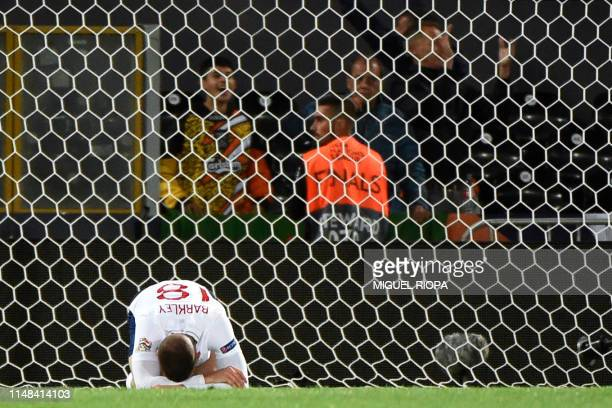 England's midfielder Ross Barkley reacts after Netherlands' third goal during the UEFA Nations League semifinal football match between The...