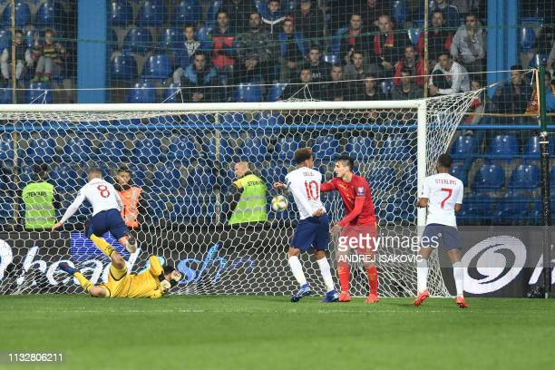 England's midfielder Ross Barkley scores a goal during the Euro 2020 football qualification match between Montenegro and England at Podgorica City...
