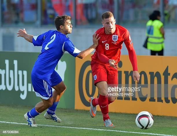 England's midfielder Ross Barkley vies San Marino's midfielder Giovanni Bonini during the EURO 2016 qualifying football match San Marino vs England...