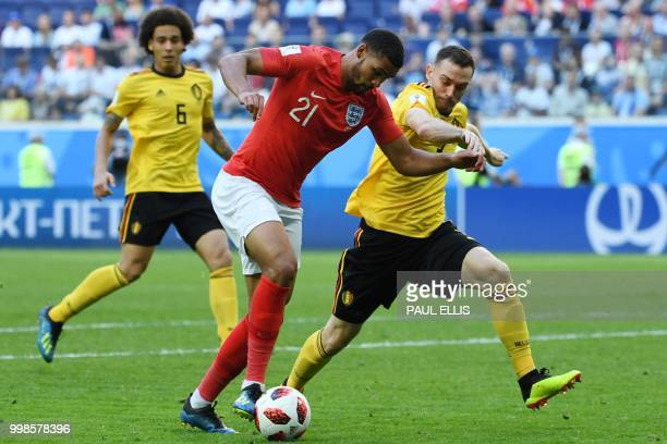 England's midfielder Ruben LoftusCheek fights for the ball with Belgium's defender Thomas Vermaelen as Belgium's midfielder Axel Witsel watches...
