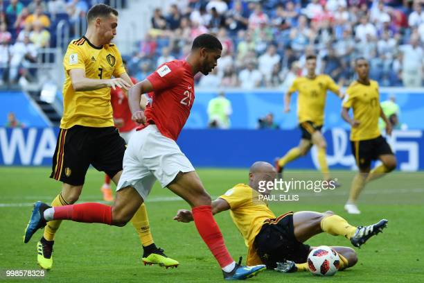 England's midfielder Ruben LoftusCheek fights for the ball with Belgium's defender Vincent Kompany during their Russia 2018 World Cup playoff for...