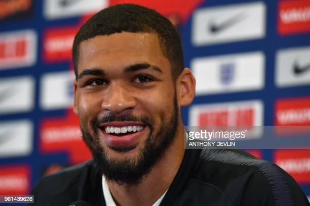 England's midfielder Ruben LoftusCheek speaks during a press conference following an England training session at St George's Park in BurtononTrent on...