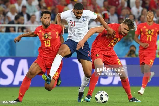 England's midfielder Ruben Loftus-Cheek vies with Belgium's midfielder Moussa Dembele and Belgium's midfielder Leander Dendoncker during the Russia...