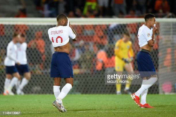 England's midfielders Raheem Sterling and Jesse Lingard react after Netherlands' third goal during the UEFA Nations League semifinal football match...