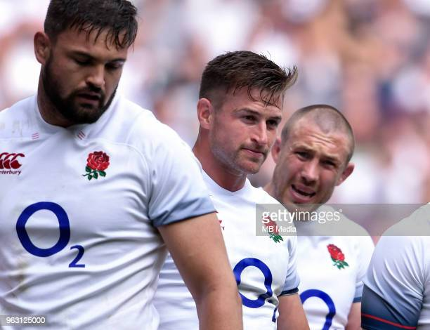England's Mike Brown Henry Trinder and Elliott Stooke dejected as Barbarians' Victor Vito scores his sides third try during the Quilter Cup match...