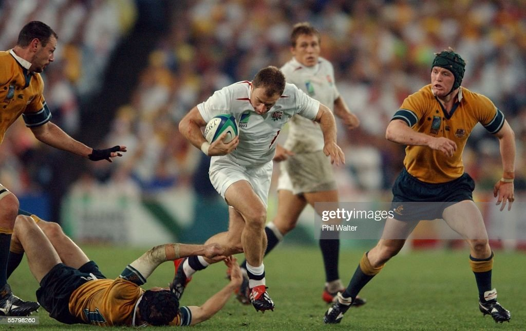 England's Mike Catt tramples over Australia's Step : News Photo