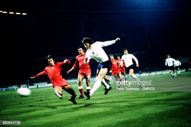 England's Mike Channon fires a shot past Poland's Miroslaw Bulzacki