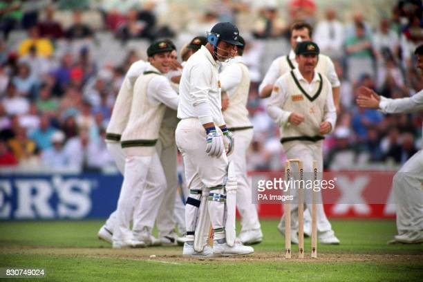 England's Mike Gatting is bowled out by Shane Warne's first delivery of the day at Old Trafford