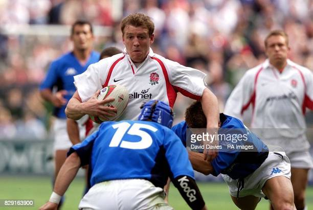 England's Mike Tindall takes on Italy's Gert Peens during his side's 459 win despite the efforts off Italy's Romiro Pez during the final match in the...