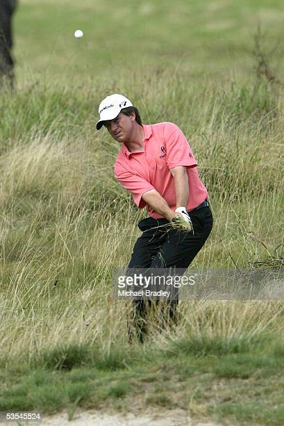 England's Miles Tunnicliff chips out of the ruff on the 11th hole at the Holden New Zealand Golf Open, played at the Gulf Harbour Country Club north...