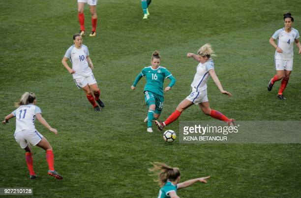 TOPSHOT England's Millie Bright fights for the ball with Linda Dallmann of Germany during of a SheBelieves Cup soccer match between England and the...