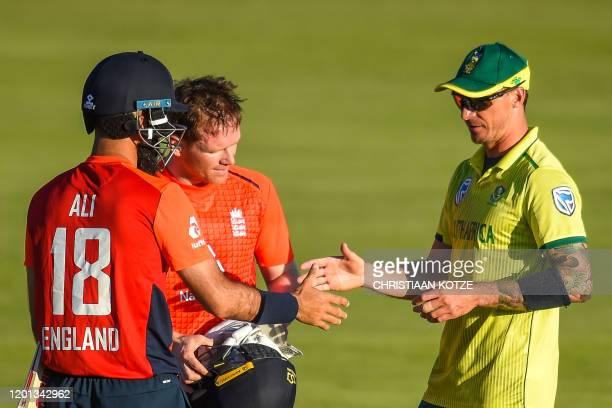 England's Moeen Ali and captain Eoin Morgan are congratulated by South Africa's Dale Steyn after winning the third T20 International cricket match...