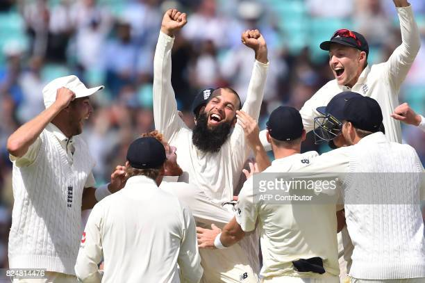 England's Moeen Ali and England cricketers celebrate victory on the fifth and final day of the third Test match between England and South Africa at...