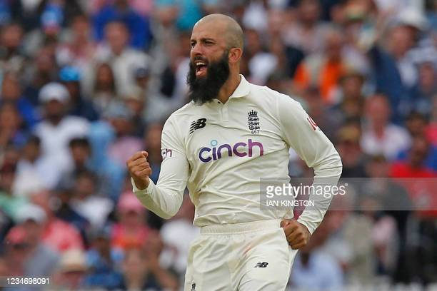 England's Moeen Ali celebrates after taking the wicket of India's Ajinkya Rahane for 61 runs on the fourth day of the second cricket Test match...