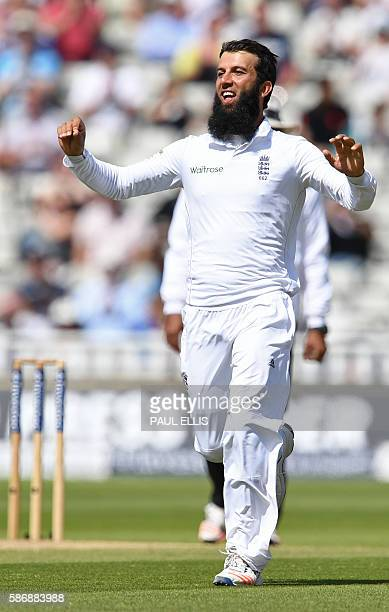 England's Moeen Ali celebrates after taking the wicket of Pakistan's Azhar Ali during play on the final day of the third test cricket match between...