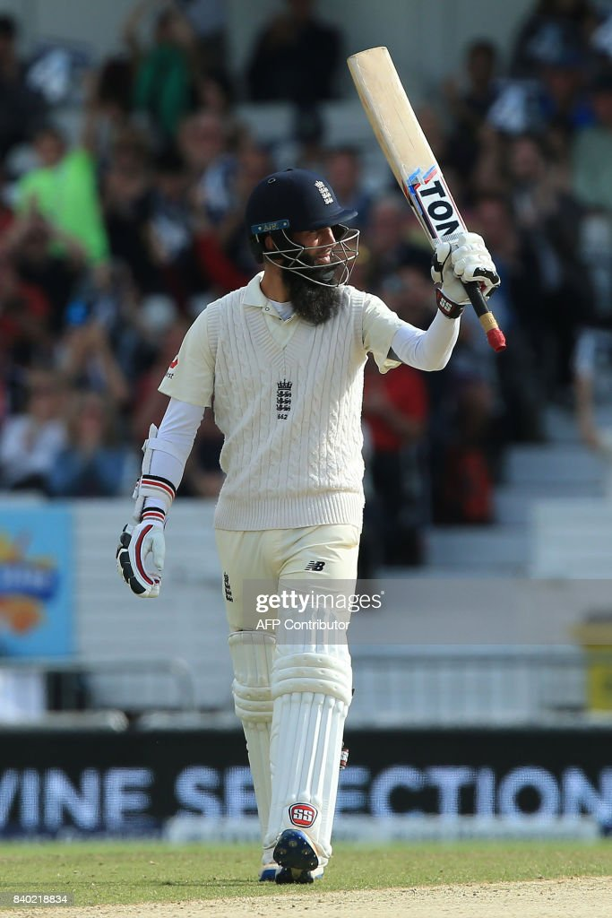 England's Moeen Ali celebrates his half century on the fourth day of the second international Test match between England and the West Indies at Headingley cricket ground in Leeds, northern England, August 28, 2017. / AFP PHOTO / Lindsey Parnaby / RESTRICTED