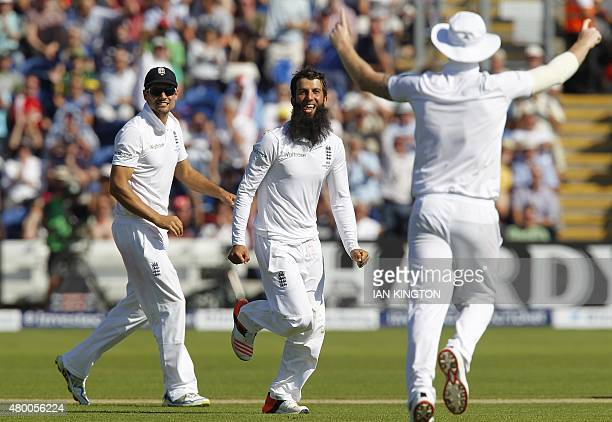 Englands Moeen Ali celebrates taking the wicket of Australias Captain Michael Clarke for 38 runs during play on the second day of the opening Ashes...