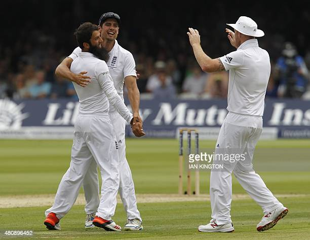 Englands Moeen Ali celebrates taking the wicket of Australias David Warner with Englands Captain Alastair Cook on the first day of the second Ashes...