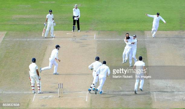England's Moeen Ali celebrates taking the wicket of India's Cheteshwar Pujara during the Fourth Investec Test at Emirates Old Trafford Manchester