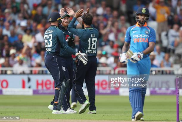 England's Moeen Ali celebrates taking the wicket of India's Shikhar Dhawan during the One Day International Series match at Trent Bridge Nottingham
