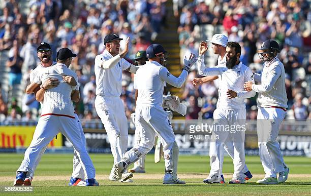 England's Moeen Ali celebrates with teammates after taking the final wicket that of Pakistan's Sohail Khan on the final day of the third test cricket...