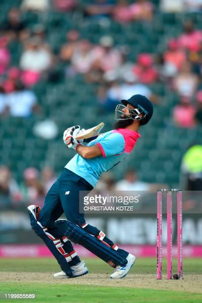 England's Moeen Ali ducks under a bounce ball during the third one day international cricket match between South Africa and England at the Wanderers...