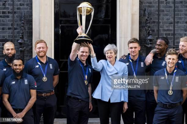 England's Moeen Ali, England's Adil Rashid, England's Jonny Bairstow, England's captain Eoin Morgan, Britain's Prime Minister Theresa May, England's...