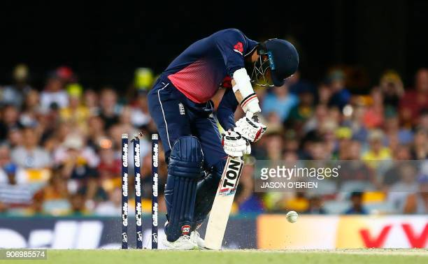 England's Moeen Ali is bowled by Australia's Mitchell Starc during the oneday international cricket match between England and Australia in Brisbane...