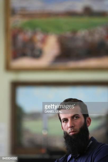 England's Moeen Ali listens to a question during a press conference at Lord's cricket ground in London on July 7 2016 The first test match between...