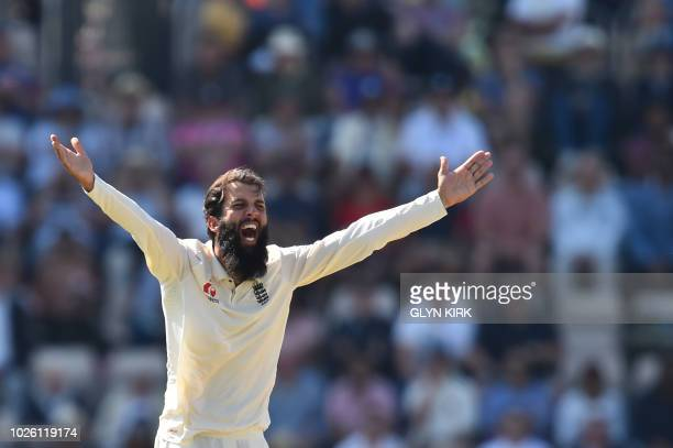 England's Moeen Ali makes an unsuccessful appeal for the wicket of India's captain Virat Kohli during the fourth day of the fourth Test cricket match...