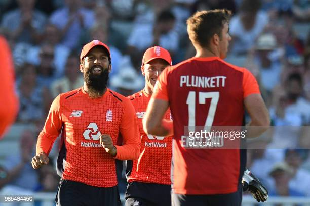 England's Moeen Ali runs to celebrate catching Australia's DArcy Short off England's Liam Plunkett's bowling during the Twenty20 International...