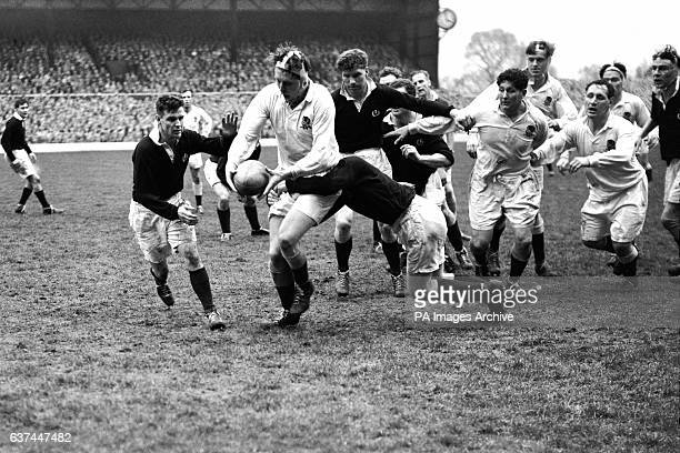 England's Muscles Currie is tackled by Scotland's Robert MacEwen