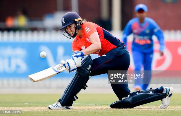 England's Natalie Sciver plays a shot against India during their women's T20 international cricket match in Melbourne on February 7, 2020. / IMAGE...