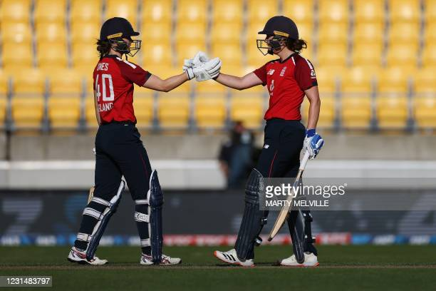 England's Natalie Sciver with teammate England's Amy Jones celebrate their win during the third women's Twenty20 cricket match between New Zealand...