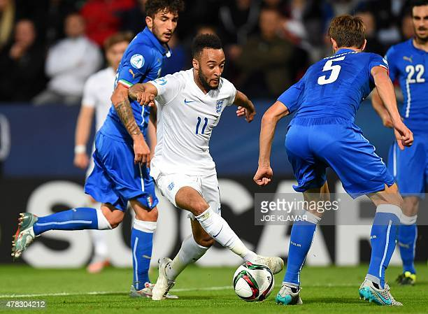 England's Nathan Redmond and Italy's Daniele Rugani fight for a ball during the UEFA Under21 European Championship 2015 group B match between England...