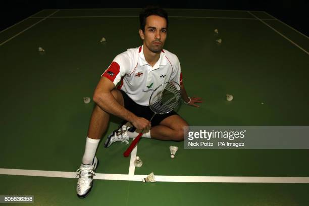 England's Nathan Robertson part of Mixed Double pair with Jenny Wallwork poses for photographs during the photocall at the National Badminton Centre...