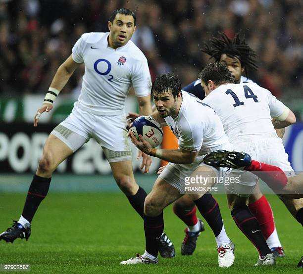 England's national team fullback Ben Foden runs with the ball during the Six Nations rugby union tournament final match France versus England on...